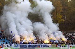 FC Dynamo Kiev team ultra supporters burn flares Stock Photos