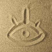 eye handwriting in the sand - stock photo