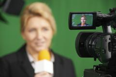 Female Journalist Presenting Report In Television Studio Stock Photos
