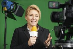 Female Journalist Presenting Report In Television Studio Kuvituskuvat