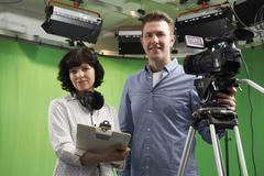 Portrait Of Cameraman And Floor Manager In Television Studio Kuvituskuvat