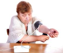 The old woman measures arterial pressure upon - stock photo