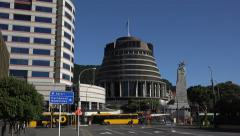 Traffic passes beehive Parliament building, Wellington, New Zealand Stock Footage
