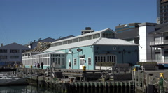 Wellington waterfront restaurants and boardwalk, New Zealand, zoom out Stock Footage