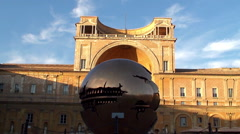 """Sphere within a Sphere"" sculpture at the Belvedere Courtyard Stock Footage"