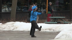 People doing tai chi outside in cold weather with snow flurries Stock Footage