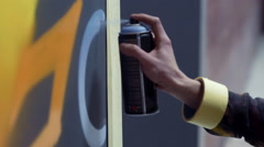 Graffiti artist painting on the wall, interior - stock footage
