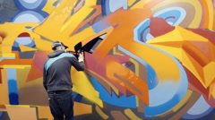 Stock Video Footage of Graffiti artist painting on the wall, interior