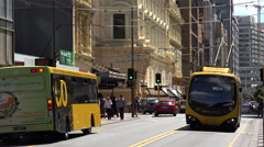Go bus, Wellington drives along Willis street, New Zealand Stock Footage