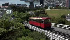 Wellington cable car arrives at Kilburn, New Zealand, zoom out Stock Footage