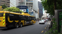 Go electric trolley buses pass ANZ bank, Wellington, New Zealand, zoom in Stock Footage
