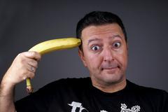 Joking with Banana - stock photo