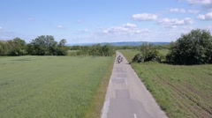 Bikers riding on the rural road Stock Footage