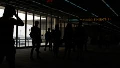 Travelers silhouettes at airport Stock Footage