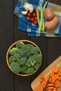 Raw Broccoli Florets and Other Vegetables - stock photo
