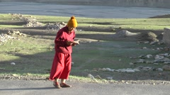 A monk walks and reads in Ki,Ki,Spiti,India Stock Footage