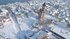 Aerial view of street traffic and buildings covered with snow. Stock Footage