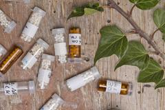 bottles with homeopathy globules - stock photo