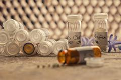 Homeopathic bottles and Pills - stock photo