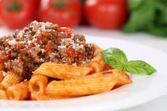 Penne Rigate Bolognese or Bolognaise sauce noodles pasta meal Stock Photos
