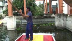 Trajineras Boat Man near Dum. Xochimilco, Mexico - stock footage