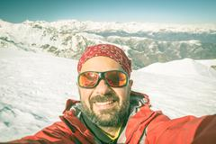 Alpin skier taking selfie - stock photo