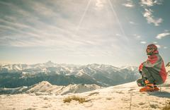 Alpinist on the mountain top - stock photo