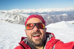 Alpin skier taking selfie Stock Photos