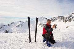Alpinist taking selfie with smartphone Stock Photos