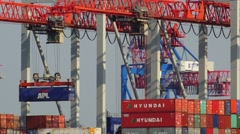 Timelapse of gantry cranes loading containers on cargo ship on March 21, 2015 in Stock Footage