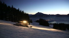 Snowcat, snow groomer in Switzerland during evening Stock Footage