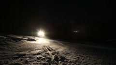 Snowcat, snow groomer in Switzerland during the night Stock Footage