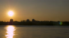 Sunset on river in city.4K (4096x2304)   Time lapse without birds, RAW output Stock Footage