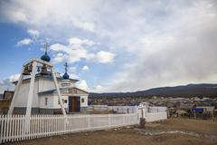 The Orthodox Church in the village of Khuzhir on Olkhon Island in the middle  Stock Photos