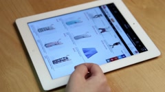 Close up woman shopping new skirt on ipad display Stock Footage