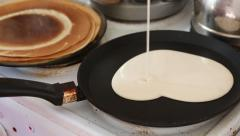 Heart shaped pancake cooked on a frying pan Stock Footage