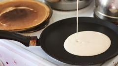 Shaped pancake cooked on a frying pan Stock Footage