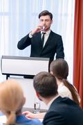 Speaker at the tribune - stock photo