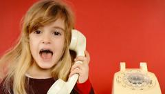 Little girl vintage telephone answer Stock Footage