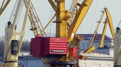 Close-up of working port crane turns to pick up cargo Stock Footage