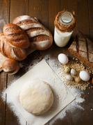 Fresh dough in flour with rye bread - stock photo