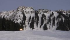 Snowcat, snow groomer in Switzerland during evening Stock Footage