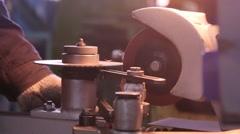 Stock Video Footage of Worker Processes piece of metal on the lathe