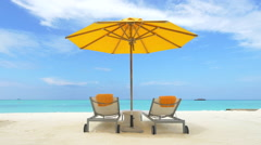 Empty loungers on exotic beach in Maldives Stock Footage