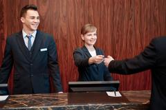 Reception at work in hotel - stock photo