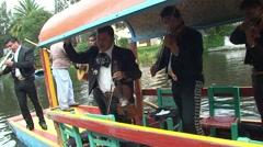 Mariachi play music on Trajineras boat - 2. Xochimilco, Mexico. - stock footage