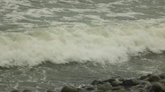 Green Ocean Waves Crash Against Rocks on Coast, Realtime Stock Footage
