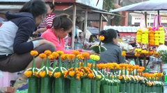 Market with temple offerings,Pakse,Laos Stock Footage