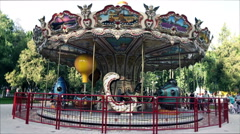 The amusement park carousel Stock Footage