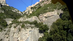 1m30s Cable Cars Passes Tower, Arrives, Aeri de Montserrat Silent Stock Footage